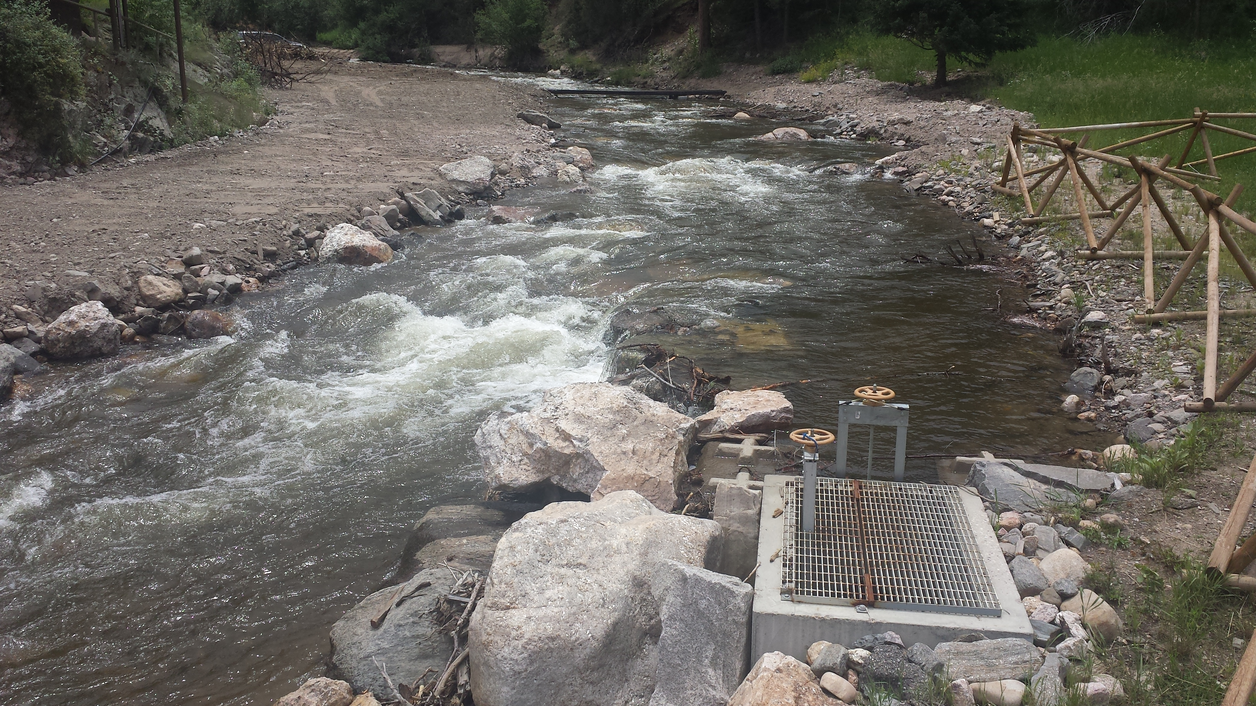 Low head boulder structures for fish-friendly irrigation diversions.